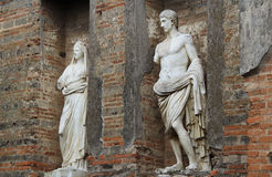 Statues in the ancient Roman city of Pompeii, Italy. Statues on a rainy day in the city of Pompeii, destroyed during the eruption of Vesuvius in 79 AD Royalty Free Stock Image
