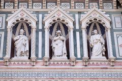 Statues of the Apostles and the fine architectural detail of the of the, Portal of Cattedrale di Santa Maria del Fiore. Cathedral of Saint Mary of the Flower Stock Photos