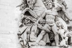 Statues on Arc de Triomphe. Details of one og the statues on Arc de Triomphe in Paris Royalty Free Stock Photos