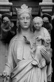 The statues and architectural elements of the main facade of Notre Dame de Paris. Stock Photos