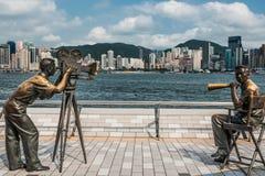Statues Avenue of Stars Tsim Sha Tsui Kowloon Hong Kong. Kowloon , Hong Kong, China- June 9, 2014: statues Avenue of Stars Tsim Sha Tsui Kowloon in Hong Kong Stock Photo