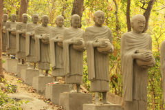 Statues of begging monks, Phnom Sombok, Kratie, Cambodia Royalty Free Stock Photo