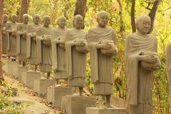 Statues of begging monks, Phnom Sombok, Kratie, Cambodia royalty free stock photo
