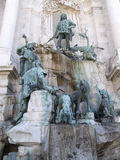 Statues by Buda Castle wall Budapest. Statues against Buda Castle wall with men and dogs in Budapest, Hungary royalty free stock images
