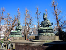 Statues of Buddha in Asakusa, Tokyo. Two statues of Buddha at Senso-ji Temple in Asakusa, Tokyo Royalty Free Stock Image