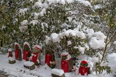 Statues of Buddha call Jizo with snow in Sendai, Japan royalty free stock images