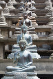 Statues of Buddha in Gangaramaya temple Royalty Free Stock Photography