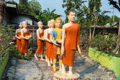 Statues of Buddha and his followers Stock Photos