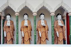 Statues of a Buddha with the Swastika Stock Image