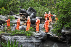 Statues of Buddhist Monks Stock Images