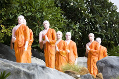 Statues of Buddhist Monks at Golden Temple. Image of statues of Buddhist monks at UNESCO's World Heritage site, the Golden Temple at Dambulla, Sri Lanka Stock Photos