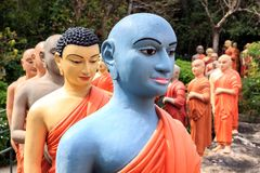 Statues of Buddhist monks standing in line to worship the Buddha. Kandy, Sri Lanka - January 9, 2018. Statues of Buddhist monks standing in line to worship the Royalty Free Stock Photography
