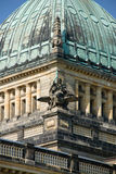 Statues on a building. Domes of a building of court of a city of Leipzig against the blue summer sky Royalty Free Stock Image