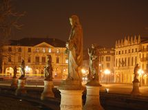 Statues and buildings at night Stock Image