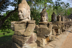 Statues in Cambodia. Rows of statues along the road to the entrance of the Angkor temples of Siem Reap, Cambodia Royalty Free Stock Photography