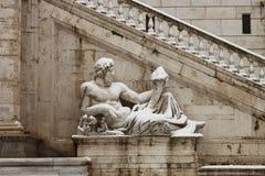 Statues in Campidoglio square under snow stock photo