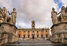 Statues of the Capitol, Rome. The Capitol in Rome on a rainy day. The picture shows the stairway leading to the capitol, palazzo senatorio and the ancient stock images