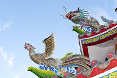 Statues carved dragon and bird on the roof shrine. royalty free stock photo