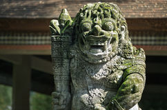 Statues and carvings depicting demons, gods and Balinese mytholo Stock Photography