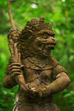 Statues and carvings depicting demons, gods and Balinese mythological deities. Royalty Free Stock Photos