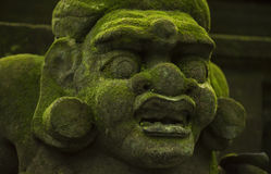 Statues and carvings depicting demons, gods and Balinese mythological deities. Royalty Free Stock Photography