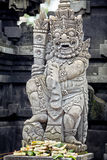 Statues and carvings depicting demons or gods with offerings Royalty Free Stock Image