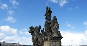 Statues on Charles bridge against blue sky Royalty Free Stock Photography