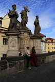 Statues on the Charles Bridge, historic buildings, Prague, Czech Republic Royalty Free Stock Images