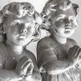 Statues of children in prayer Royalty Free Stock Photography