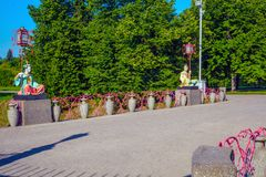 Statues of Chinese with large lanterns on poles sitting on the Big Chinese bridge in the Alexander Park, Tsarskoe Selo, Pushkin. St. Petersburg, Russia - July 30 Royalty Free Stock Photo