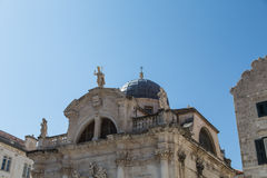 Statues by Church Dome in Dubrovnik royalty free stock images