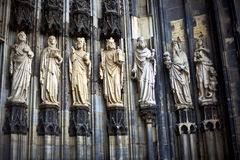 Statues in Cologne Dom. A detail of the main facade of the Cologne Cathedral in Cologne, Germany. The lower row of statues from left to right: Prophet Moses Royalty Free Stock Photos