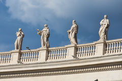 Statues on the colonnades.  St. Peter`s Square. Piazza San Pietro. Vatican City. Italy Royalty Free Stock Images