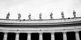 Statues on colonnades that surround St. Peter's Square in Rome Royalty Free Stock Photography