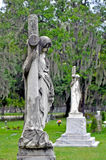 Statues and crosses at a cemetery Royalty Free Stock Photo