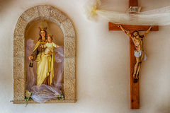 Statues of the Crucifixion and of the Blessed Virgin Mary with B royalty free stock photos