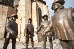 Statues of D'Artagnan and the three musketeers. Statues of the four musketeers in Condom, in the Gers, in the southwest of France. They represent D'Artagnan Stock Image