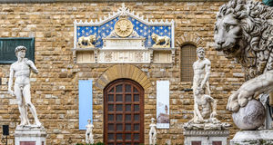 Statues of David and Hercules near Palazzo Vecchio in the Piazza della Signoria. Medici lion, Loggia dei Lanzi. Florence, Italy royalty free stock images