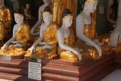 Statues de Bouddha en position de Bhumiparsa Mudra Photos stock
