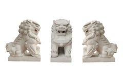 Statues de lion dans le style chinois sur le fond blanc Photo libre de droits