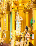 Statues of deities in the Buddhist temple. Stock Image