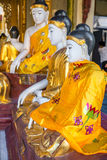 Statues of deities in the Buddhist temple. Stock Images