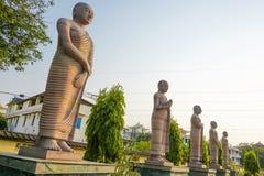 Statues des premiers disciples du Bouddha image stock