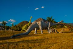 Statues of dinosaurs in the clearing. Prehistoric animal models, sculptures in the valley Of the national Park in Baconao, Cuba. stock image