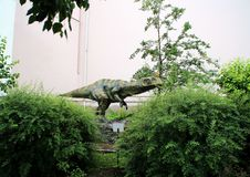 Statues of dinosaurs and extinct animals in the courtyard of the State Darwin Museum. royalty free stock photography