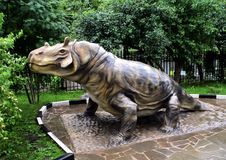 Statues of dinosaurs and extinct animals in the courtyard of the State Darwin Museum. stock image