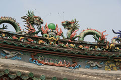 Statues of dragons decorate the roof of a temple (Vietnam) Royalty Free Stock Photography