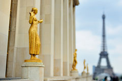 Statues and Eiffel tower Royalty Free Stock Photo
