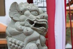 Statues en pierre de lion Images stock