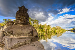 Statues at the entrance of Angkor Thom Stock Photography